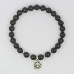 About us all silver products in my store are pure handmade and unique designed by us 100% solid sterling silver 925 and accessories we have many kinds of beads handmade genuine leather and genuine exotic products using the absolutely good materials timeless designs that will never go out of fashion  Description model number : 10MBA30 beaded : 10mm skull beaded : 14.7 mm x 23.5 mm / 5.4 g  material: solid Sterling Silver 925 / black agate come with jewelry pouch bag  ( bracelet size ...