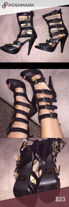 Enigma Gladiator Super Sexy Multi-buckle Heels Super sexy does not even describe these heels!  Vavavoom!  💋.   Faux leather and very comfortable. They zip in the back and adjustable for narrow or more curvy calves. Fits true to size. Great condition and worn only once.  Black with gold tone hardware. Enigma Shoes Heels