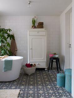 warm white bathroom #tiles #greenery #cabinet