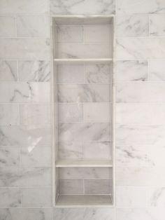 Carrara marble shower niche - clean look                                                                                                                                                      More