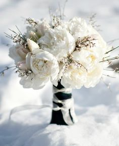 This is a beautiful White Wedding Flower arrangement for a centerpiece