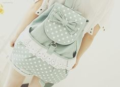 Pretty green and white polka dot