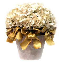 Silk hydrangea arrangement in a pot with gold-hued bows.   Product: Faux floral arrangementConstruction Material: Si...