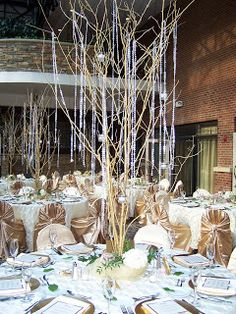 Branch centerpieces with hanging crystals, gold and white