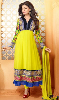 Yellow Sushmita Sen Georgette Long Anarkali Suit You'll be bound to make a impressive fashion statement like Sushmita Sen with this yellow georgette long Anarkali suit. You are able to see some intriguing patterns accomplished with floral patch, gold zardosi and resham work. #LongAnarkaliSuitsCollection #AnarkaliSalwarKameez