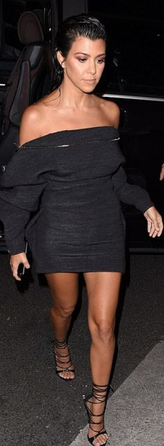 Who made  Kourtney Kardashian's black lace up sandals and off the shoulder dress?