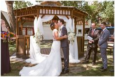 Couple's first kiss at their outdoor summer wedding ceremony. For more multicultural weddings, check out our blog: www.sujataphotography.com/blog