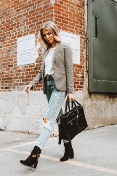 Checked blazer over white tee with trendy distressed jeans.
