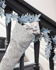 Accentuate your holiday décor with the delicate beauty of our Winter Frost Leaves Floral Spray this holiday season.