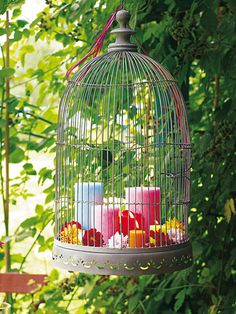 A decorative cage: Arrange pillar candles and flowers in it and hang it - it takes hardly any space :D