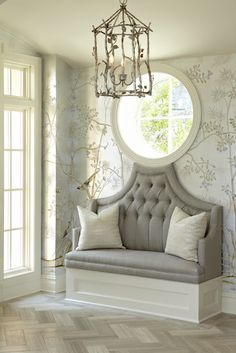 Designer Donna Benedetto - limestone tiles laid in herringbone pattern, custom settee to fit the window