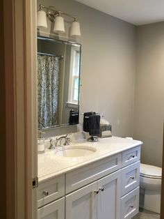 """Beautiful Medallion """"Park Place"""" White Icing vanity with """"Whitney"""" quarts vanity top in a bathroom in Andover, MA. White Icing, Wet Bars, New Construction, Baths, Vanity, Mirror, Park, Bathroom, Top"""
