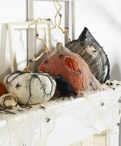 "30 Pumpkin Decorating Ideas from Midwest Living. Check out this ""Creepy Mantel"" - pumpkins draped in cheesecloth. #Halloween"
