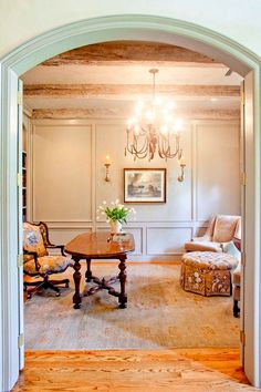 love arched doorway, light fixture, ceiling, and walls