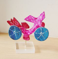 Pink metal bike sculpture with blue wheels by AkatosCollectibles, $26.50
