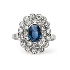 Kenosha is a gorgeous vintage sapphire and diamond halo engagement ring from Trumpet & Horn! // $5,500