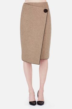The striking lines of this double-faced wool knit skirt are edged in two-thread overlock stitching for a modern approach to contrast piping. Designed for a straight fit, the skirt has an angled wrap-front panel that is secured by a snap closure and creates a layered, asymmetrical front hem.
