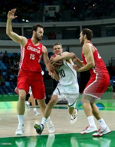 Rio 2016 Olympics - Basketball --  Renaldas Seibutis of Lithuania is challenged by Miro Bilan of Croatia and Bojan Bogdanovic of Croatia  (800×1024)