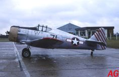 North American T-6 disguised as a single seater fighter for a film, at Le Havre, F-AZBE (13-09-83)