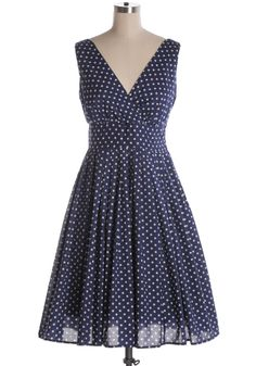 Indie, Retro, Party, Vintage, Plus Size, Convertible, Cocktail Dresses in Canada NEW: April Showers Dress in Navy - It may be raining but you're still smiling in this navy all cotton dress with polka dots. A-line with pleated skirt and a v-neckline. Side zipper. 100% cotton Not stretchy Lined Fits large Styling Tip: Easy to layer with a cream cardigan for extra warm, or pair with heels for a classy day look!