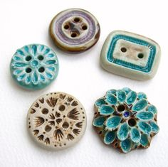 Handmade ceramic and glass buttons.