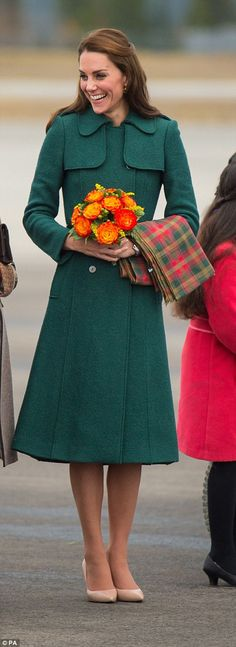 Kate later pulled on a thick green Hobbs coat over her £2,000 Dolce and Gabbana green dress from earlier in the day
