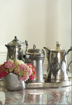 Silver Quad-plated water pitchers or possibly coffee pots. Hard to see the size.