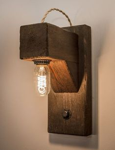 """""""The Hangman"""", was inspired by the classic word game. This rustic wall sconce includes a dimmable Edison bulb """"hung"""" below a protruding beam. The exposed cloth covered rope wire loops over the top Rustic Bathroom Lighting, Rustic Wall Sconces, Bathroom Light Fixtures, Rustic Walls, Rustic Lighting, Rustic Wood, Wood Sconce, Rustic Industrial, Sconce Lighting"""