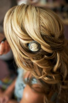 """You could incorporate your grandmother's brooch for your """"something borrowed"""" into your hair."""