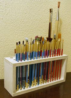 Paintbrush holder. https://www.etsy.com/listing/178205269/wooden-paintbrush-holder-for-craft