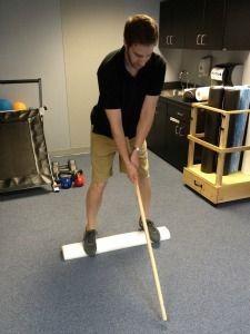 Foam Roller Exercises - Golf swing on foam roll for balance