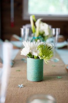 The kind of simple I like: twine and soup cans as centerpieces?