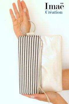 Pochette pliée zippée cuir et coton