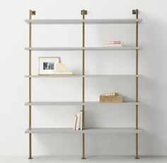 RH TEEN's Avalon Double Shelving:The sleek lines of our collection capture the sophisticated restraint of modernism, while its polished cast-metal fittings – including recessed pulls and a metal base – take it in a new direction.