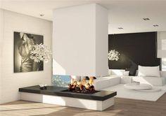 Um dos ambientes mais aconchegantes e pitorescos é uma sala com lareira. Mas o design e a modernidade transformou este ambiente.  Qualdos mo...