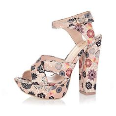 I have a strange fascination with bizarre shoes as of late! x    Pink print platform sandals - River Island
