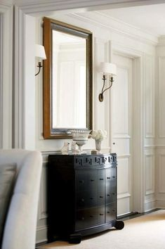 New England Home - entrances/foyers - chair rail, wainscoting, decorative, wall moldings, black, Greek key, chest, gold, Greek key, mirror, double sconces, greek key chest, black greek key chest,