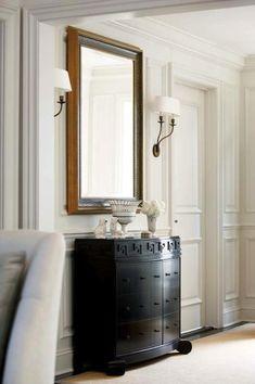 New England Home - entrances/foyers - chair rail, wainscoting, decorative, wall moldings, black, Greek key, chest, gold, Greek key, mirror, double sconces, greek key chest, black greek key chest,