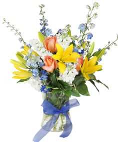 Jean Estelle-This gorgeous arrangement features pastel spring flowers with pops of vibrant yellow lilies! Inspired by the shift from spring to summer, we love this arrangement! Named after the mom of the winner of our Mother's Day contest, this arrangement is a true embodiment of mothers everywhere - graceful, sweet, and effortlessly beautiful!  #Lilies #Flowers #NanzAndKraftFlorists #LouisvilleFlowers