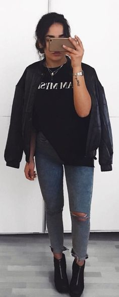 #winter #outfits black crew-neck t-shirt and blue distressed denim jeans outfit