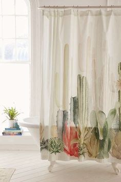 Love this cactus landscape shower curtain! By Urban Outfitters.