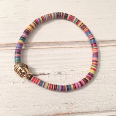 This listing is for the neon vinyl disc beaded bracelet with a gold plated buddha bead. Vinyl disc beads are each. Summer Bracelets, Cute Bracelets, Colorful Bracelets, Jewelry Bracelets, Yoga Bracelet, Stretch Bracelets, Buddha Beads, Bead Loom Bracelets, Diy Jewelry Making