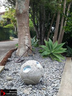 Ponga Log garden edging and mulching design and construction by