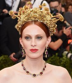 Karen's gold headpiece appears as if a floral bush was dipped in gold.