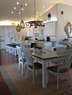 Renovated Home, beautiful coastal Canadel dining table set and barstools designed by Andrea Z