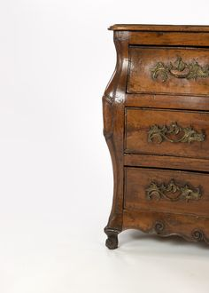 A Louis XV Provincial walnut bombe commode, mid 18th century. Serpentine top above undulating drawer fronts with snail scroll ornamentation on a conforming apron above scrolled cabriole feet, Circa 1750. height: 34 in. 86 cm., width: 49 in. 124.5 cm., depth: 23 in. 58.5 cm. #rocaille #louisxv #frenchprovincial #louisxvfurniture #commode #vintagecommode #frenchantiques #sf #sanfrancisco #volptuous #curves #bombe bombé #luxe #classicaldecor