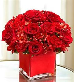 RED ROSES RED ASTROMELIA AND RED CARNATION