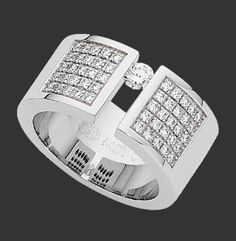 Wide Tension Set Diamond Ring With Diamonds Band C809   18ct white gold wide ring with one off centre tension set and fifty watch set round brilliant cut diamonds on the band, polished finish