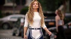 Modern-day: Next we see her in the 1990s in a white top and blue slacks. Women gather on the street to dance in unison. Jennifer's hair is longer than ever with blonde tones