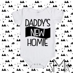 ♥daddy's new homie♥ •100% cotton •short sleeve •white •3 snap closure for easy diapering •lap shoulder for easy dressing/undressing •soft, comfortable, and made with quality All Designs Exclusive to ©                                                                                                                                                                                 More